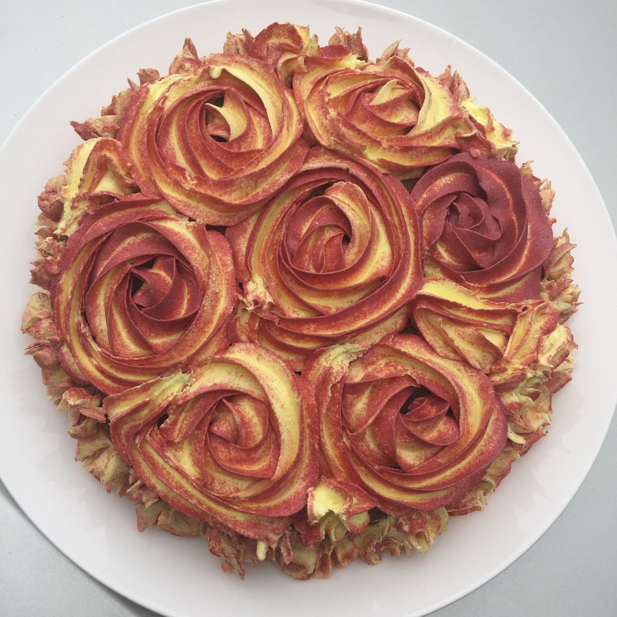 Celebration Cake Chocolate Cake With Fancy Butter Cream Icing In Yellow And Maroon Rosettes